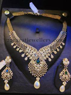 Jewellery Designs: Radiant Daimond Set with Emeralds