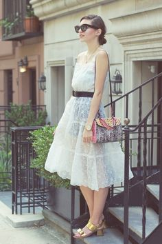 Emilee Anne wearing Vintage Petticoat Dress // Ferragamo Belt // Marni Gold Bow Sandals // Marc Jacobs Python Purse // Celine Sunglasses