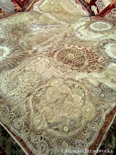Suziqu's Threadworks quilt made out of doilies and velvet. Wow!