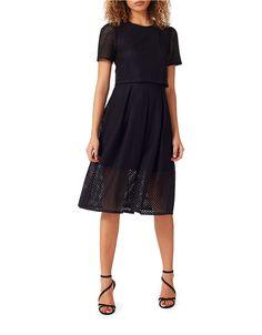 <ul> <li>An on-trend, double-layered design in edgy mesh</li> <li>Roundneck</li> <li>Short sleeves</li> <li>Pleated skirt</li> <li>Exposed back zipper</li> <li>Partially lined</li> <li>Nylon/cotton</li> <li>Machine wash</li> <li>Imported</li> </ul>
