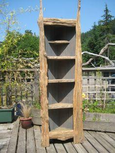 Coolest idea in using old barn wood. I love corner cabinets:)