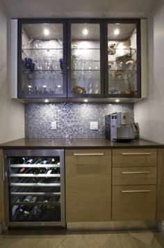 bar with wine cellar and glass doors for showing off glassware.