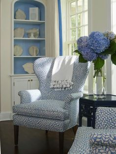 So peaceful-just blue hydrangeas in a simple vase in a blue  white room.