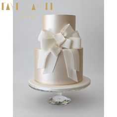 Shimmer cake with Vera Wang inspired sash by Faye Cahill Cake Design