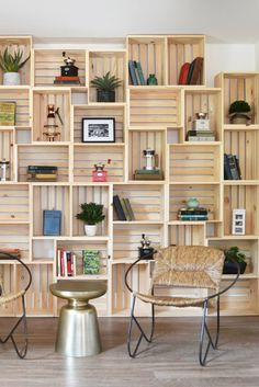 Wooden crates create a simple storage solution when stacked along the wall to…