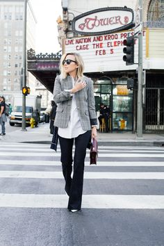 How To Wear Flared Jeans: Jacey Duprie is wearing a pair of dark denim Reformation flares
