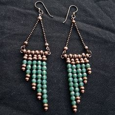 The angle of these earrings reminds me of sweeping palace steps, hence the name. Two shades of copper all-metal seed beads set off the smoky emerald green crystal, and are echoed by the Nunn Design… Diy Jewelry Gifts, Homemade Jewelry, Jewelry Crafts, Wire Jewelry, Beaded Jewelry, Jewelery, Diy Jewelry Necklace, Jewelry Rings, Diy Schmuck