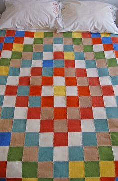#quilt-like, #color!  This is a sort of pseudo-quilt: a riff on a quilt pattern without the sandwich element that makes a quilt quilted.  I really like the extra bit of edge texture created by sewing felt squares together in this manner, and the colors are great fun.