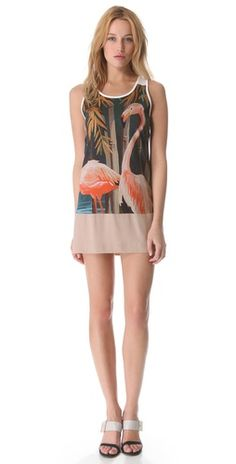 No. 21 Flamingo Tank Dress + FREE SHIPPING at shopbop.com. No. 21 prints a simple tank dress with a slightly pixelated digital flamingo print, giving the casual silhouette a hint of artistic cool. The solid, contrast crepe hem lends a graceful finish.