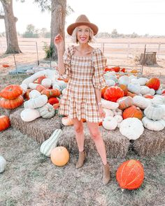 I found the cutest $32 smocked plaid dress for fall! Pair it with a short pair of ankle boots or a taller one as it cools off.