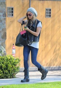 Ashley Tisdale wearing Louis Vuitton Monogram Vernice Key and Change Holder, Urban Outfitters Slouchy Ribbed Beanie in Gray, Frye Veronica Slouch Boots in Black Distresses, Chanel Caviar Giant Shopping Tote Gst Bag in Black, J Brand 12 Pencil Jeans, Super Zeiss Rock Hard Sunglasses in Red, Alexander Wang Leather Vest and Soixante Neuf Butterfly Ring.