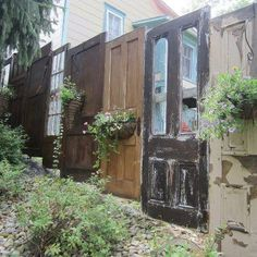 Privacy fence made of doors. Love this!