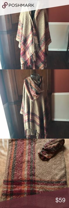 Free People Ruana plaid hooded fringe Free People ruana. This shawl is plaid. It has a hood and fringe. It is in perfect condition. One size fits all. This will be the perfect piece for fall and winter! The garment is 46 inches in width and 27 inches in length, including the fringe. Thanks for visiting my closet! Free People Accessories Scarves & Wraps
