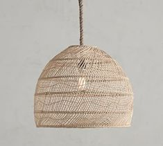 Woven of natural materials, the Flora Rattan Pendant adds softly diffused light to a room. A rope cord and bronze-finished frame complement the look of this lighting – a perfect choice for any space, whether a master bedroom or a small se Rattan Pendant Light, Pendant Light Fixtures, Coastal Light Fixtures, Rattan Light Fixture, Drum Pendant, Lantern Pendant, Star Pendant, Basket Lighting, Outdoor Lighting