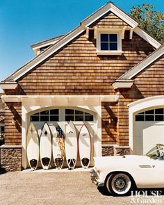 Surfboards lined up along the garage of a Newport, Rhode Island, estate, welcome the arrival of summer and the time to take it easy.
