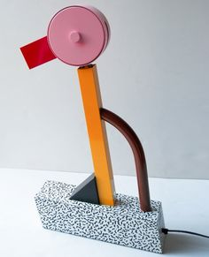 "Tahiti table lamp designed by Ettore Sottsass for Memphis, 1981.   Plastic laminate & metal.   Uses 50W halogen. 23.5"" h 