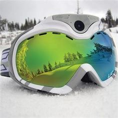Best ski tracker, skiing gadgets and GPS wearables to improve your technique. Camera Goggles, heated gloves, avalanche beacons and even smart helmets Snowboarding, Skiing, Home Design Magazines, Best Skis, Wooden Sandals, Living In Alaska, Ski Goggles, Spy Camera, Fitness Tracker