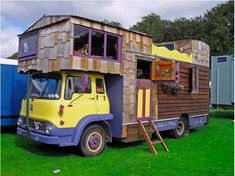 """They call 'em """"housetrucks."""" These road beasts are usually handmade, formed from a truck with the bed removed and a living space installed—and they come in all shapes and sizes. This behemoth even has an open-air upper deck!"""