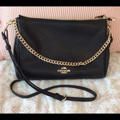 ✨BRAND NEW ✨ Leather Coach Purse 100% AUTHENTIC black pebble leather Carrie coach purse with gold detailed accents, especially zipper and tab as photoed. Perfect size its bottom is 2 inches wide; 11 inches side to side at its widest point and 7 inches top to bottom the bag is large enough to hold essential items including wallet and make-up but not too big. Black leather adjustable straps can be shortened or extended to make the bag over the shoulder or cross body are on clips so can be…