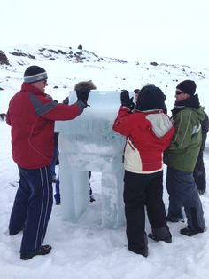 Building an inukshuk - team-building Iqaluit style