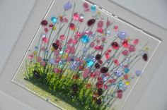 Wild gardens are vibrant with many variety of flowers attracting the butterflies. This piece will remind you of summer all year around even on the dullest of days. The piece is then fired for 12 hours at approx 800c to fuse the glass and paints together. The frame surrounding my picture is an off white which sets off the colours perfectly.  Glass tile is approx 10cm x 10cm, surrounded by a double mount. The frame is approx 25cm x 25cm. Each piece is individually painted and made so…