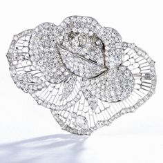 FORMERLY IN THE COLLECTION OF MARLENE DIETRICH PLATINUM AND DIAMOND ROSE BROOCH, CIRCA 1930