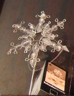 Snowflake ornament - inspiration - I need to make a special snowflake ornament - been looking for ideas - this appears to be looped wire and beads - i really like this!