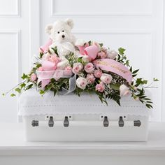 The FTD® Touch of Sympathy™ Casket Spray S47-4555