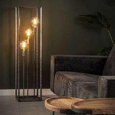 This Luther floor lamp is a designed with an open rectangular cage. The lamp is made of metal with an old silver finish. The lamp has industrial characteristics. Operable with a switch on the cord. Wooden Floor Lamps, Industrial Floor Lamps, Industrial Ceiling Lights, Industrial Table, Living Room Designs, Living Room Decor, Beige Living Rooms, Led Lampe, Interior Decorating