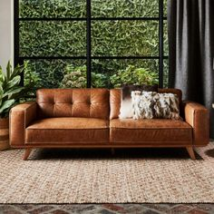 Our Carson two seater retro sofa is a modern and elegant nod to mid-century living room chic – all wrapped in a layer of gorgeous top-grain leather. Brown Leather Couch Living Room, White Leather Sofas, Best Leather Sofa, Leather Lounge, Brown Sofa, Chesterfield Leather Sofa, Cream And Brown Living Room, Green Leather Sofa, Brown Lounge