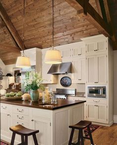 Beautiful kitchen!  Love the lights over the island and that ceiling! Sometimes I think super high ceilings take away from the cozy factor but not here! What do you think? Via @verandamag