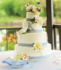 Wedding Cakes: Outdoor wedding cake with yellow flowers and butterflies and lettering