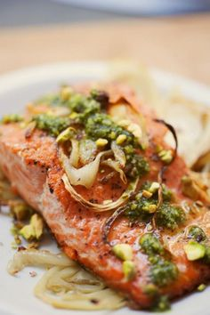 {Wild Alaskan salmon with pistachio pesto and roasted fennel.}.