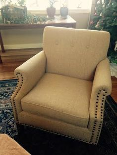 Reupholstered Single Cushion Chair with Decorative Nailhead Trim.
