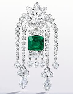 PLATINUM, EMERALD AND DIAMOND BROOCH – An emerald and diamond brooch centered by a 22.48-carat Colombian emerald sold for two point nine million– - Photo courtesy of Sotheby's