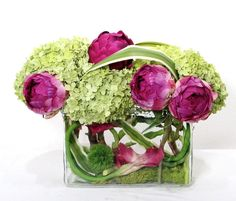 A beautiful arrangement of green hydrangeas, pink peonies and calla lily.