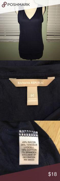 Banana Republic navy blue Sleeveless Vneck top Banana Republic navy blue Sleeveless Vneck top with Satin Vneck outline. Great condition Banana Republic Tops Tank Tops