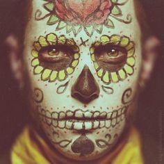 Masquerade ball should be in the style of la Dia de Los Muertos