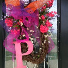 Cute spring wreath I just made for my front door using mesh deco ribbon, grapevine and a few flowers. Top off with a letter 'P' for my name and I'm done!