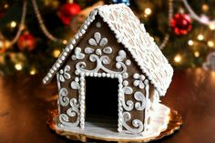Simple gingerbread house with white trim/deco