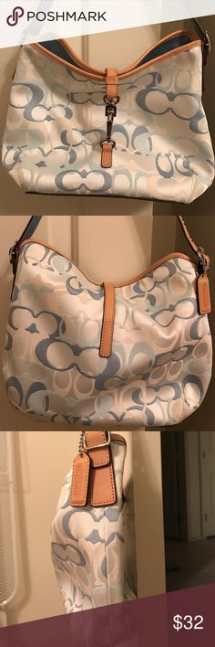 Blue and White Coach Handbag Blue and white Coach Handbag with tan trim. Older style- bought approximately 10 years ago but still in great shape. Clip closure. I have the dust bag as well (shown in the last pic with the bottom of the bag). Coach Bags Shoulder Bags