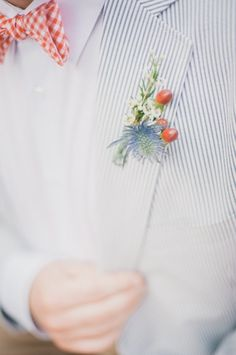 boutonniere inspiration, maybe replace the thistle with blue Veronica?