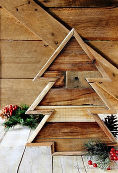 Transform pallet wood into a tiny tree you can prop up on a mantel, entryway, or front porch. Get the tutorial at Thistlewood Farms. RELATED: 27 Ideas to Trim Your Christmas Tree
