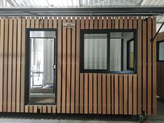 Constructed from two conjoined B-grade shipping containers, this spacious maintenance office doubles as a storage room and includes an ablution facility with a toilet and sink. Beautified with external Balau cladding, this converted shipping container office also features a fold up roof and porch, sliding windows and steel swing doors. #shippingcontainers #containerconversions #officecontainer #containercladding #shippingcontaineroffice #containerconstruction Shipping Container Conversions, Converted Shipping Containers, Shipping Container Office, Mobile Office, Sliding Windows, Container Homes, Storage Room, Storage Containers, Cladding