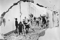 """Henri Cartier-Bresson and """"The Decisive Moment"""" Works from The Dorsky Museum's Permanent Collection. (Henri Cartier-Bresson, Boys Playing Amidst Ruins—Spanish Civil War, 1937, Museum Purchase, 1960.003)"""