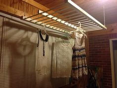 """Side of an old crib repurposed to hang """"line dry only"""" clothes in my mudroom! I love it already!"""