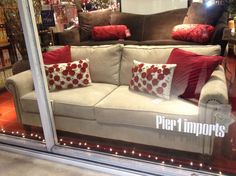 Pier 1 Alton Sofa in Ecru with red pillows - here it is again, only with red pillows. Not my thing, but the sofa is MY THING! Love the neutrality and the nailhead trim. It's really beautiful!