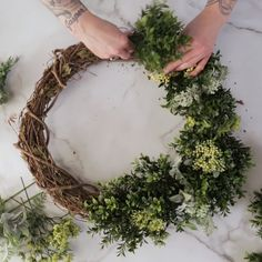 Faux boxwood and artificial sprigs of greenery make up this simple, long-lasting wreath. Create your own DIY boxwood wreath and display it season after season. diy videos simple How to Make a Faux Boxwood Wreath Christmas Wreaths To Make, Holiday Wreaths, How To Make Wreaths, Christmas Crafts, Christmas Decorations, Make Your Own Wreath, Artificial Christmas Wreaths, Christmas Greenery, Table Decorations