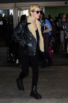 Celebrity Airport Shoe Style: Ellie Goulding paired her Coach leather jacket with black Dr. Martens.
