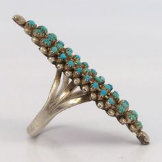 """Vintage (1970s) Sterling Silver Ring set with a Cluster of Natural Turquoise. Ring Size: 7 .625"""" Width, 1.875"""" Height .125"""" Band Width"""